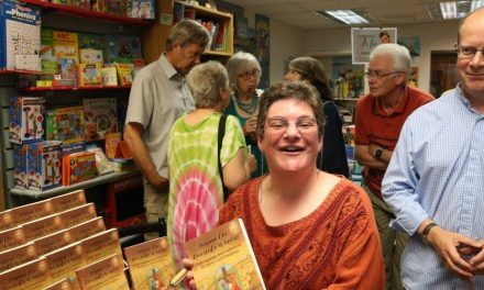 Book launch draws crowd away from football!