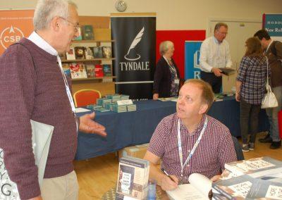 Rob Cotton signing books